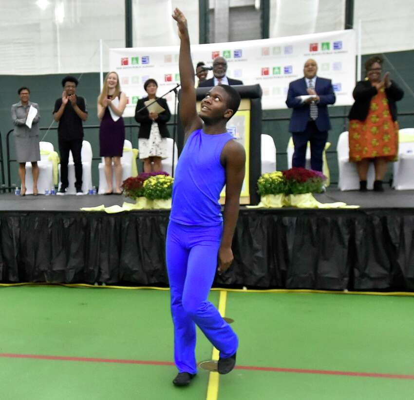 Dancer Bradyn Pettway, 16, a senior at Cooperative Arts and Humanities High School in New Haven, performs during the 2019-20 school year convocation Tuesday morning at the Floyd Little Athletic Center at Hillhouse High School.