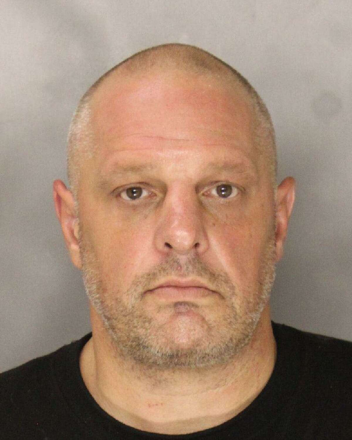 Brian Ross, 49, was arrested on suspicion of attempted robbery, burglary and criminal conspiracy.