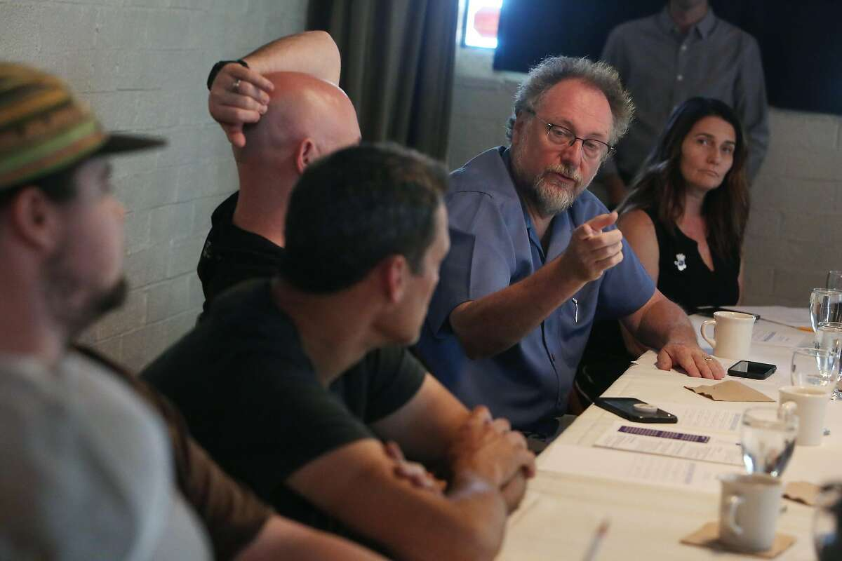 Patrick Mulvaney (second from right), co-owner Mulvaney's B & L� , speaks to staff from various Sacramento restaurants during an