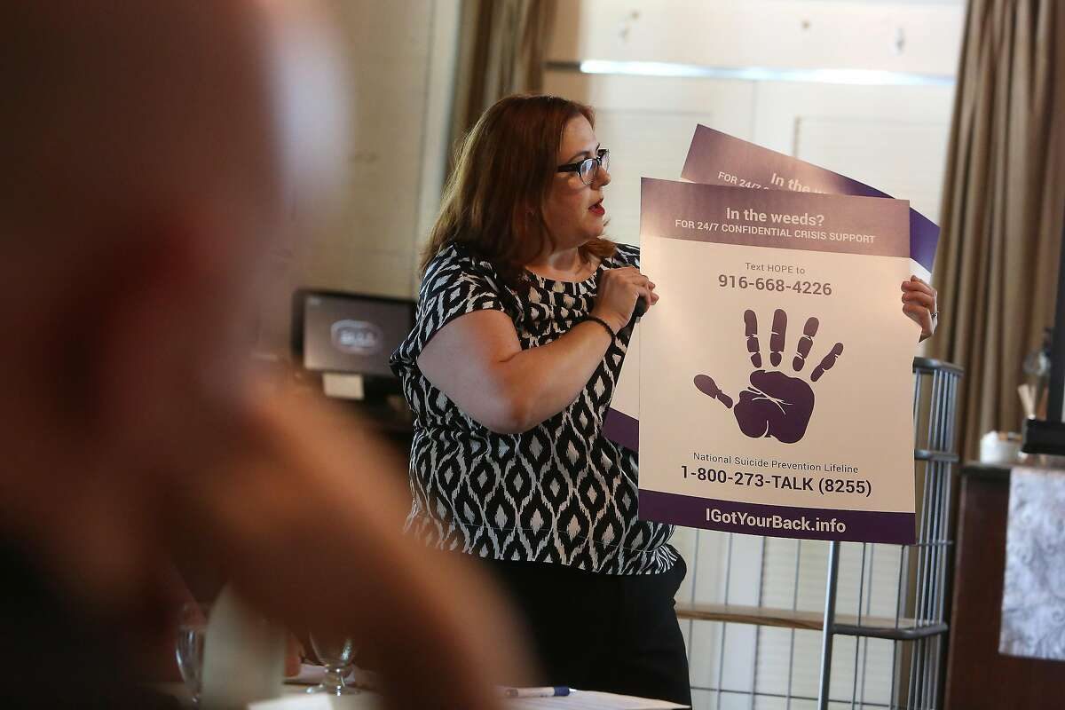 Jeannie Howell, director Third Plateau, speaks to staff from various Sacramento restaurants during an