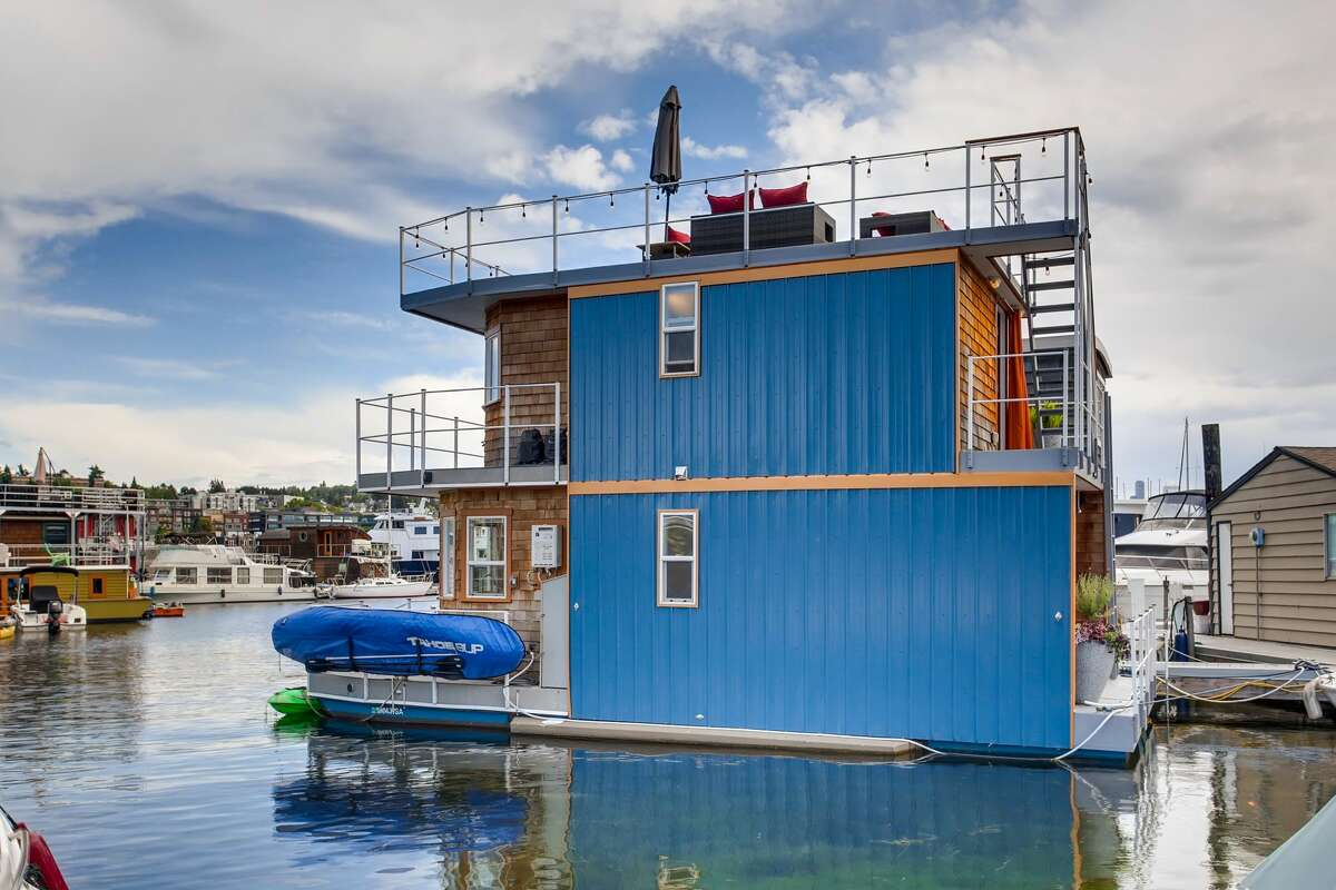 For the price of a condo, you could live in this $489K free-standing (or floating) home with a roof deck overlooking Lake Union.