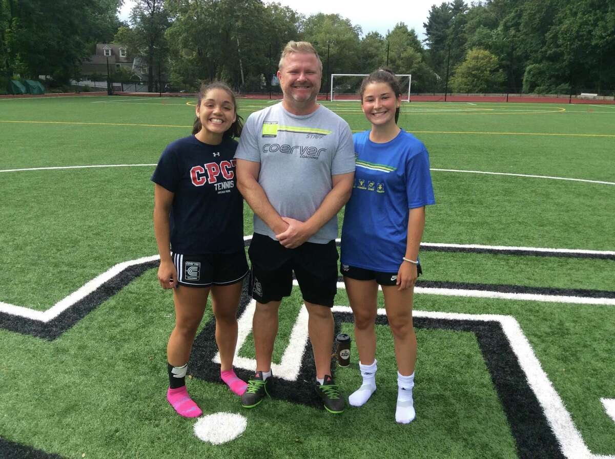 Christina Maldonado is a senior captain of the Greenwich Academy soccer team, which is coached by Alistair Lonsdale, center. At right is Taylor Lane, also a senior captain.