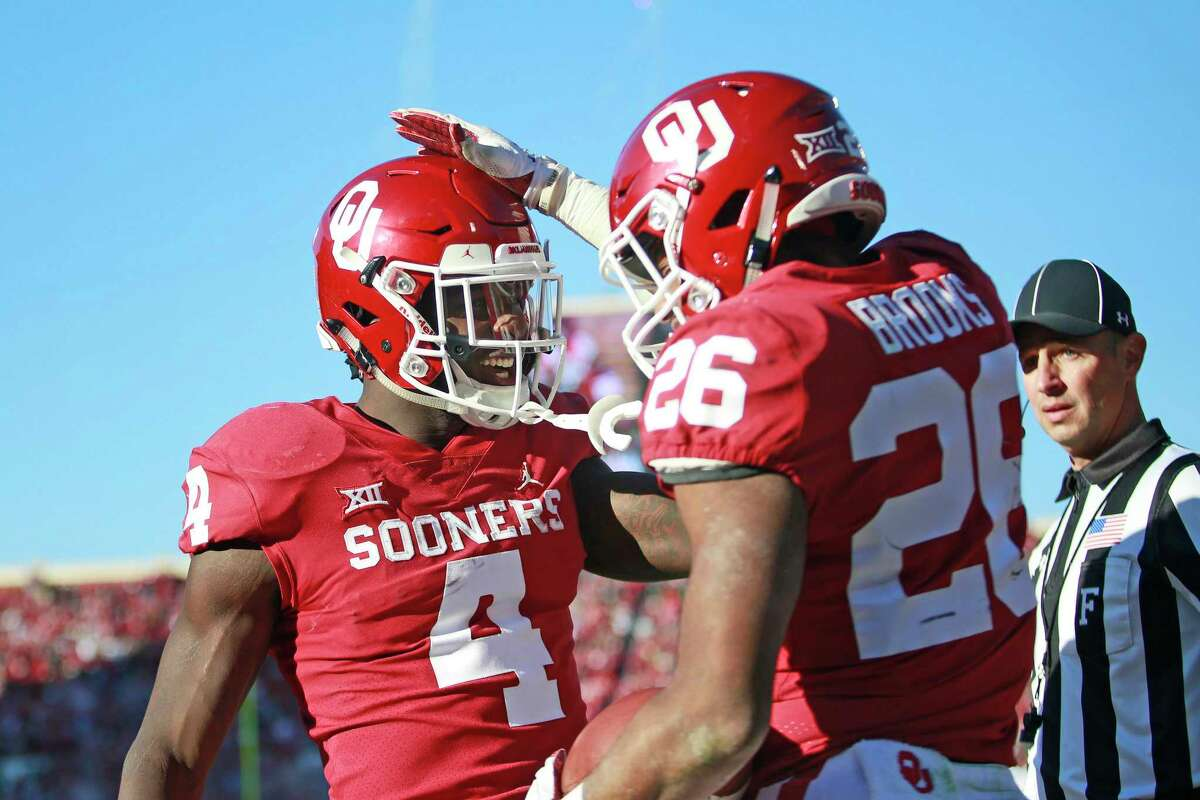 Running backs Trey Sermon (4) and Kennedy Brooks (26) are only part of the Oklahoma offense that UH most stop in the opener on Sept. 1 in Norman.