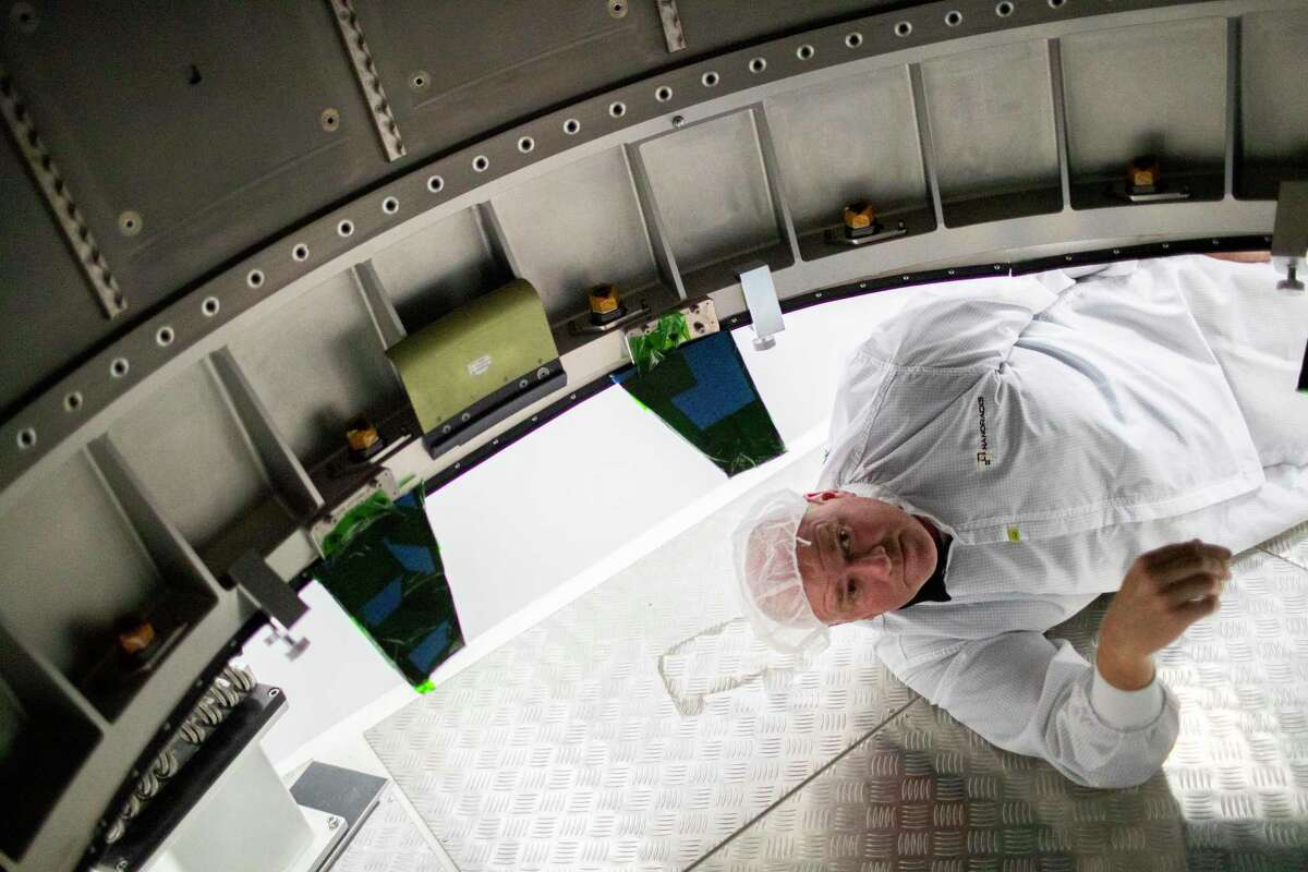 Brock Howe, NanoRacks airlock project manager observes inside the NanoRacks Bishop Airlock module on Wednesday, Aug. 14, 2019, in Webster.