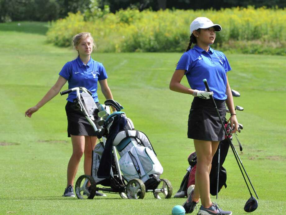 Hannah Byun of Shaker watches her drive as her teammate Emily Bette watches on during a match against Albany Academy on Tuesday, August 27, 2019, at Van Patten Golf Club. (Joyce Bassett / Times Union) Photo: Joyce Bassett