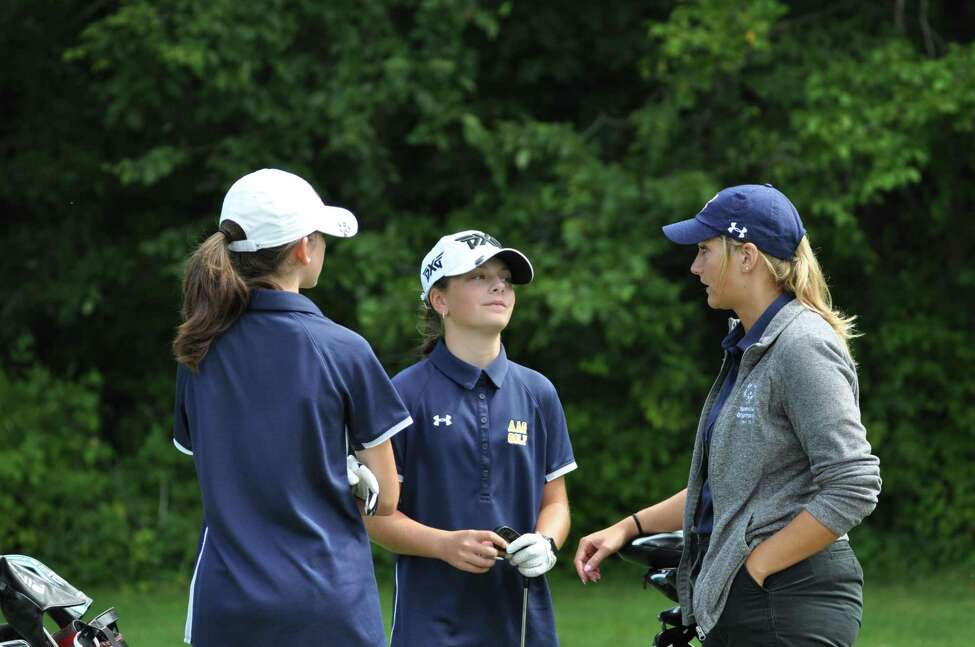 Kennedy Swedick of Albany Academy, center, and Nicole Criscone, with Albany Academy girls' golf head coach Sarah Adamowski during a match against Shaker at Van Patton Golf Club on Tuesday, August 27 2019. Adamowski and Siobhan Matrose, head coach of Shaker, said their teams are excited about the first year of Section 2 competition. (Joyce Bassett / Times Union)