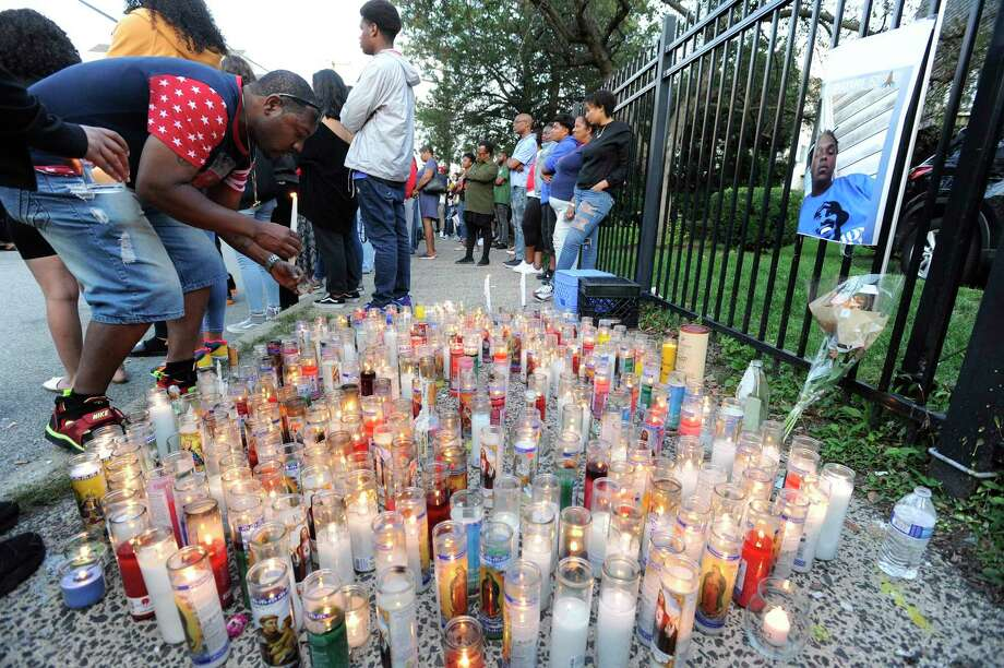 Kenneth Johnson of Hartford lights a remembrance candle for his nephew Ky-Mani Antoine-Pollack on Tuesday August 27, 2019 where more than hundreds of friends gathered on Ludlowe Street in Stamford, Connecticut to hold a vigil and reflect on the loss of their friends. Kymoni Pollock and NiShawn Tolliver were killed in a car crash early Monday morning. Four other individuals were injured in the crash at Canal and Ludlowe Street near Pollocks homothers involved in the crash. Photo: Matthew Brown / Hearst Connecticut Media / Stamford Advocate