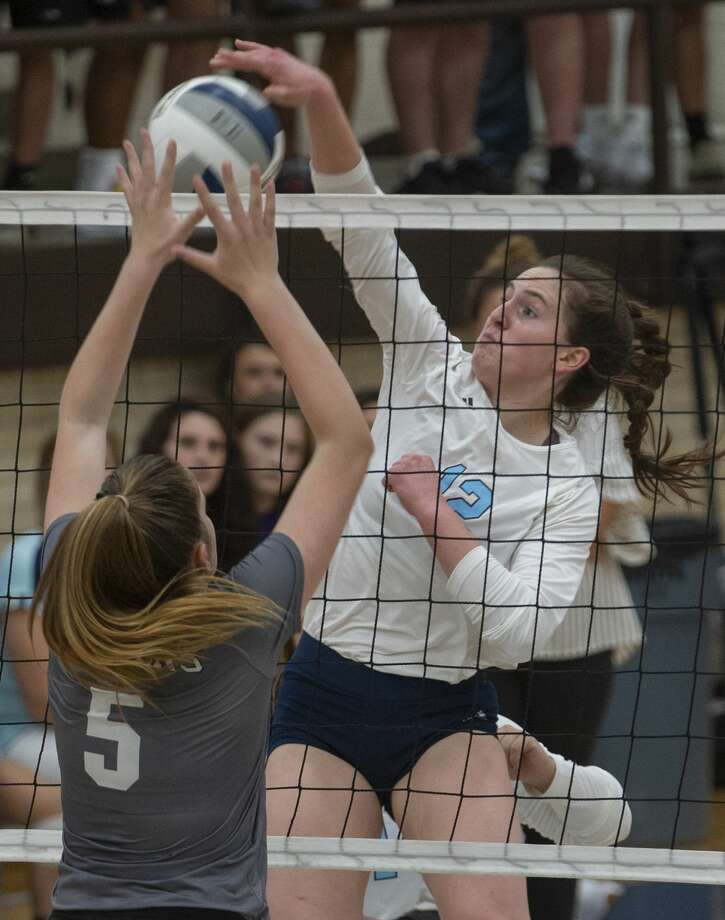Greenwood's Mattie Huber misses her mark and hits into the net as Seminole's Zoee Nolen goes up to block 08/27/19 in Greenwood. Tim Fischer/Reporter-Telegram Photo: Tim Fischer/Midland Reporter-Telegram