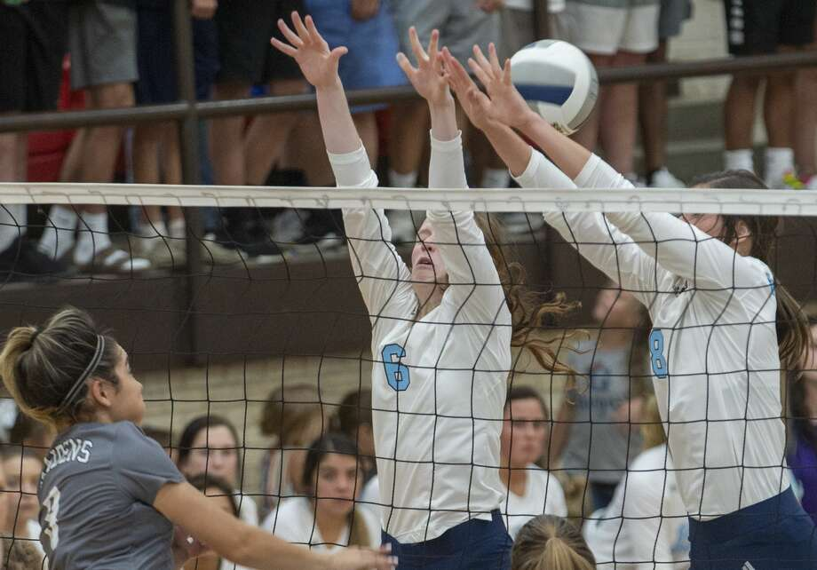 Seminole's Xyla Madry hits the ball between Greenwood's Edie Coleman and Kylee Smith as they try to block 08/27/19 in Greenwood. Tim Fischer/Reporter-Telegram Photo: Tim Fischer/Midland Reporter-Telegram