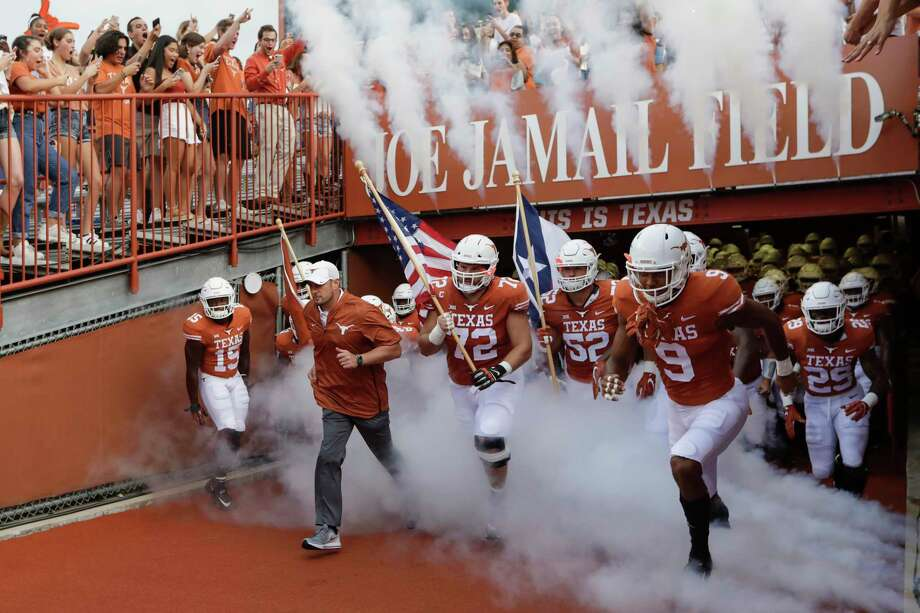 AUSTIN, TX - SEPTEMBER 08: Head coach Tom Herman of the Texas Longhorns leads the team on to the field before the game against the Tulsa Golden Hurricane at Darrell K Royal-Texas Memorial Stadium on September 8, 2018 in Austin, Texas. (Photo by Tim Warner/Getty Images) Photo: Tim Warner, Stringer / Getty Images / 2018 Getty Images