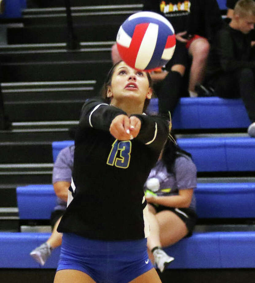 Roxana libero Makenzie Keller bumps the ball during match Monday night at the Roxana Tournament. Keller, a junior, returns after leading the Shells in digs last season. Photo: Greg Shashack / The Telegraph