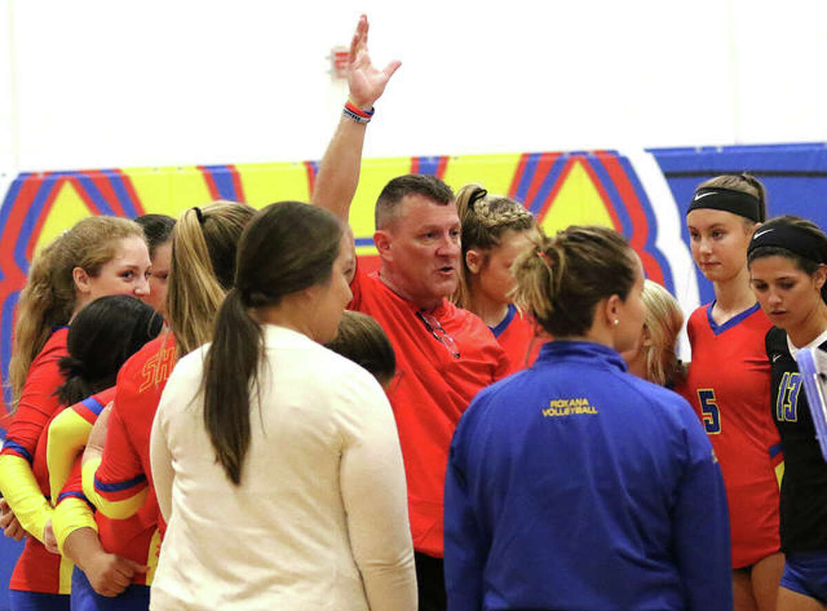 Roxana coach Mike McKinney talks to his team during a timeout in a match against Gillespie on Monday night at the Roxana Tourney. McKinney begins his 25th season as Shells coach.