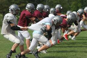 The Cass City varsity football team practices Tuesday afternoon in preparation for Thursday night's season opener against visiting powerhouse Montrose-Hill McCloy.