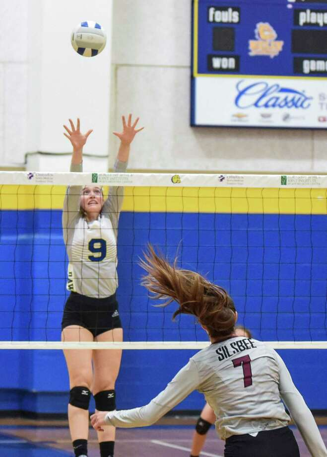 Kelly's Annalise Burbank jumps up to block during the game at Kelly High School Tuesday. Kelly won the matchup against Silsbee 3-1.  Photo taken on Tuesday, 08/27/19. Ryan Welch/The Enterprise Photo: Ryan Welch, Beaumont Enterprise / The Enterprise / © 2019 Beaumont Enterprise