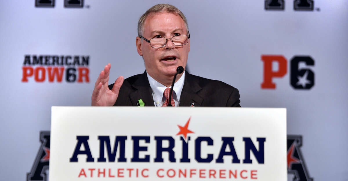 American Athletic Conference commissioner Mike Aresco speaks at AAC media day at Gurney's Newport Resort and Marina Tuesday, July 16, 2019. With UConn set to leave the conference in June, the league plans to file paperwork seeking an NCAA waiver that would allow it to eliminate football divisions. (Brad Horrigan/Hartford Courant/TNS)