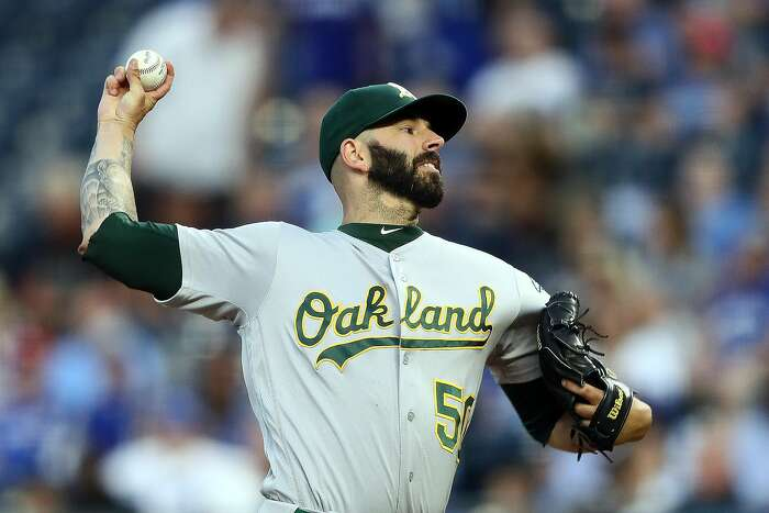 KANSAS CITY, MISSOURI - AUGUST 27: Starting pitcher Mike Fiers #50 of the Oakland Athletics pitches during the 1st inning of the game against the Kansas City Royals at Kauffman Stadium on August 27, 2019 in Kansas City, Missouri. (Photo by Jamie Squire/Getty Images)