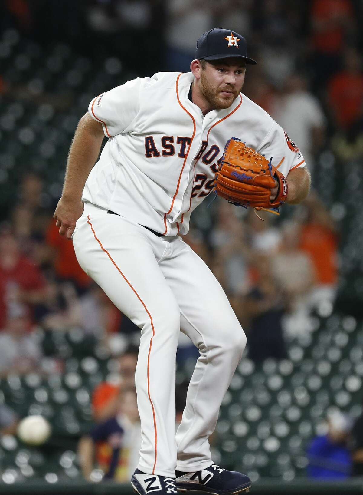 Houston Astros relief pitcher Joe Biagini (29) spins around as Tampa Bay Rays Austin Meadows grounded out during the ninth inning of an MLB baseball game at Minute Maid Park, Tuesday, August 27, 2019.