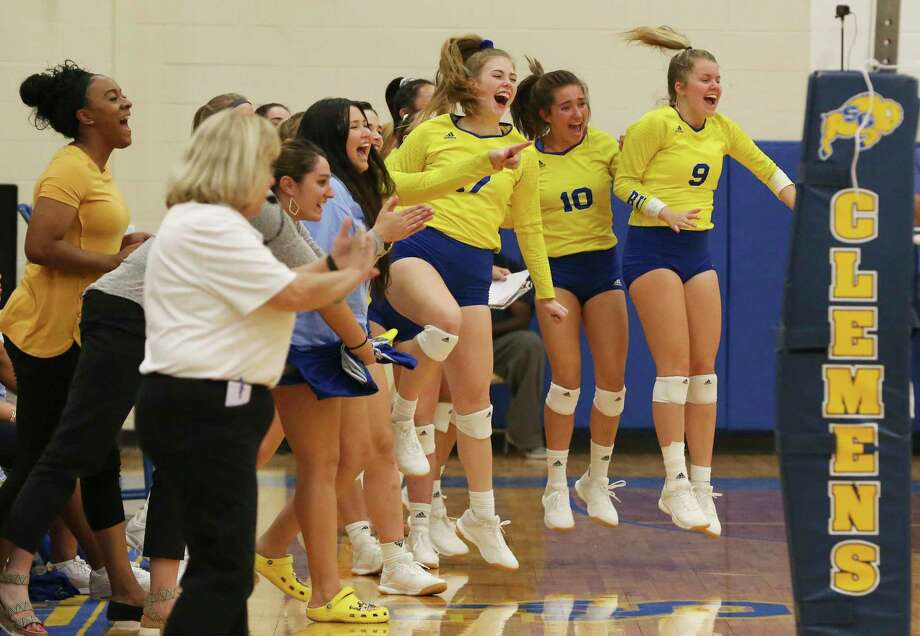 The Clemens bench gets off their feet after a score during their game against Antonian in girls volleyball at Clemens on Tuesday, Aug. 27, 2019. Clemens defeated Antonian without dropping a game, 3-0. (Kin Man Hui/San Antonio Express-News) Photo: Kin Man Hui, Staff / Staff Photographer / ©2019 San Antonio Express-News