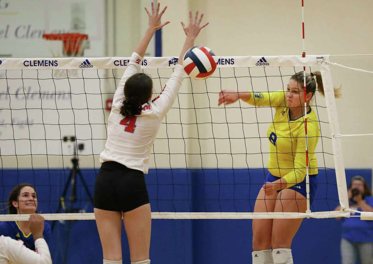 Clemens' Canada Buchanan (08) scores on Antonian's Lauren Bick (04) in girls volleyball at Clemens on Tuesday, Aug. 27, 2019. Clemens defeated Antonian without dropping a game, 3-0. (Kin Man Hui/San Antonio Express-News)