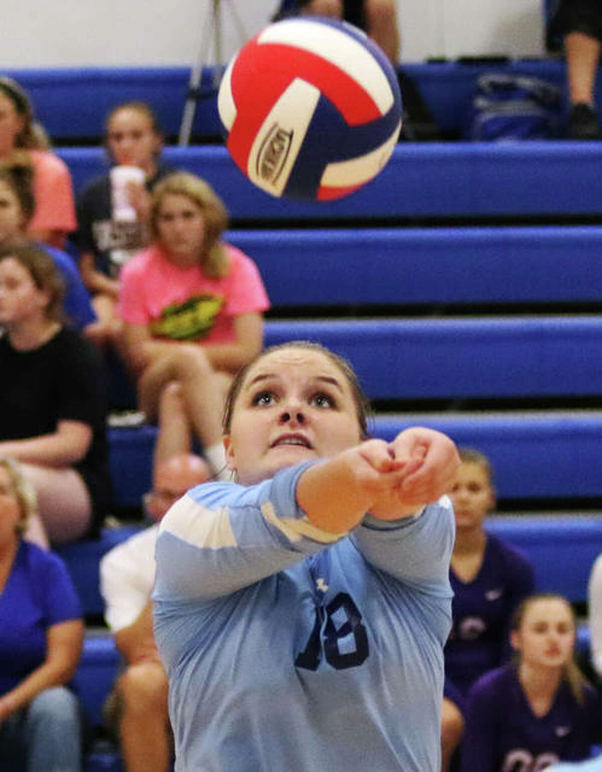 Jersey setter Abbie Droege makes a bump set on Monday at the Roxana Tournament.