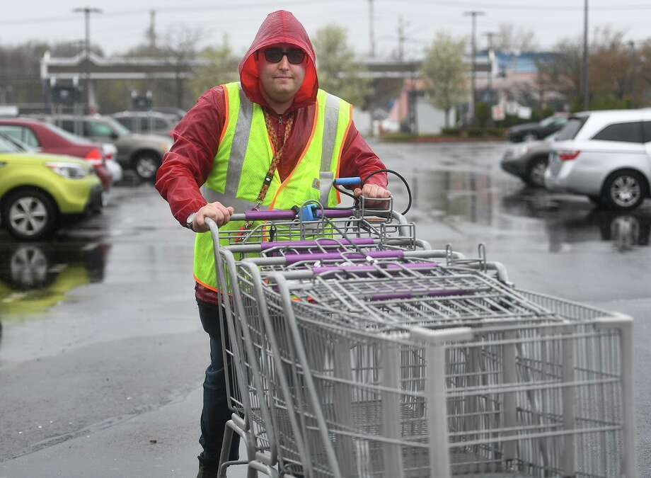 Stop & Shop employee Justin Klein, of Milford, retrieves shopping carts outside the store at 855 Bridgeport Avenue in Milford, Conn. on Monday, April 22, 2019. An 11 day strike by employees ended at the grocery store chain after a tentative agreement was reached on Sunday. Photo: Brian A. Pounds / Hearst Connecticut Media / Connecticut Post