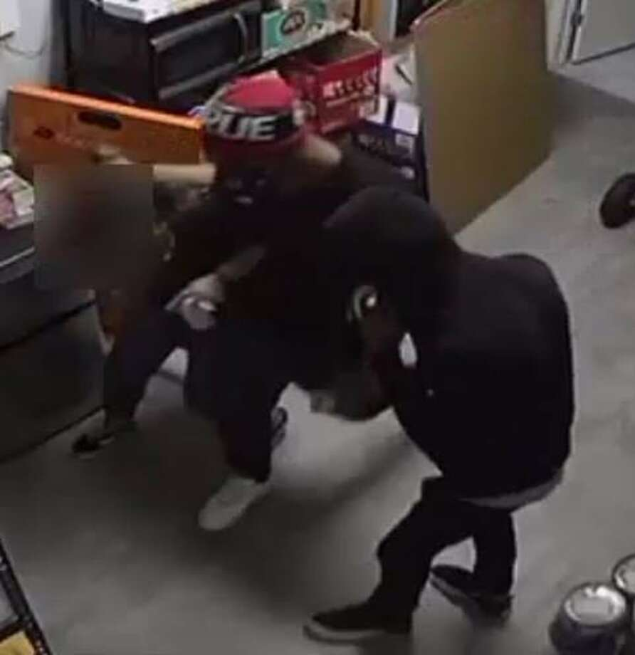 Crime Stoppers and Houston Police are asking the public for their help identifying two suspects accused of aggravated robbery. Photo: Houston Police Department