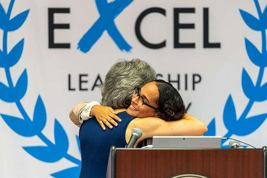 Natalia Rodriguez hugging her favorite high school teacher, Maria Zampano, on Aug. 20 during the Summer Institute sponsored by the ExcEL Leadership Academy at Shelton High School. Photo: Elias Rosario / Contributed Photo / Connecticut Post