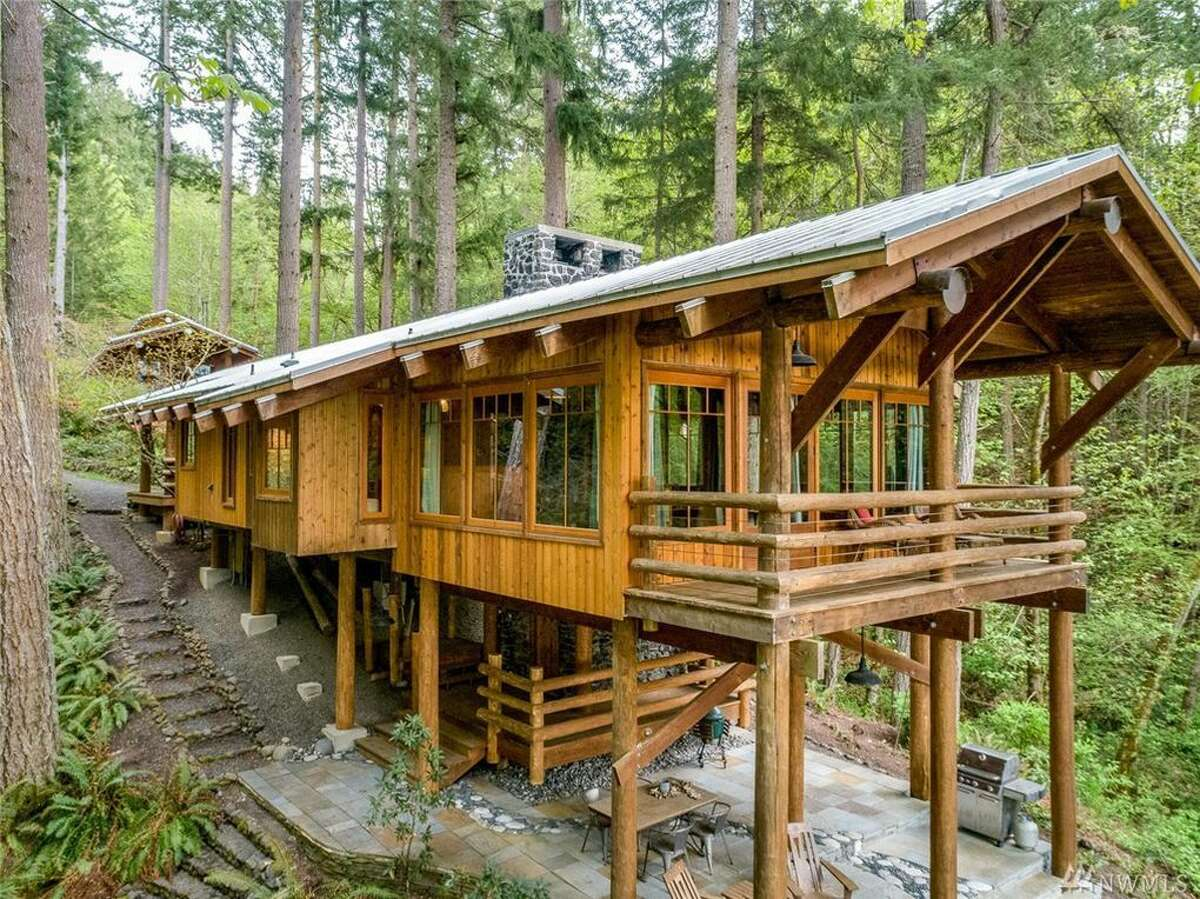 The 2,250-square-foot, cedar-built home just west of Seattle is listed for just under $1.7 million.