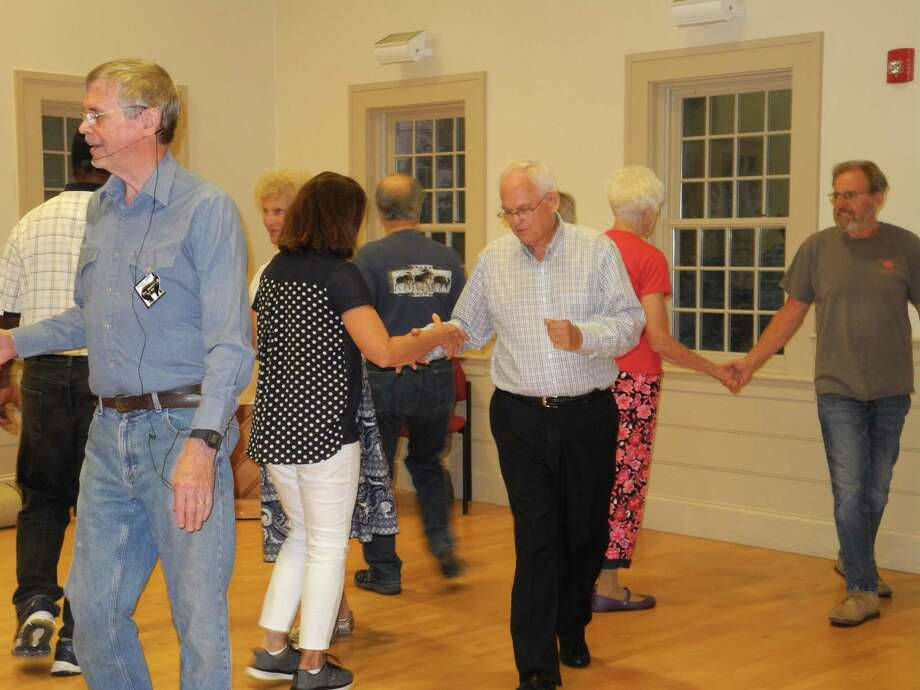 Caller Ron Baldwin, left, and Peter Engstrom, center, are among the members of the Square Bears who square dance Wednesday evenings at Wilton Congregational Church. Photo: Jeannette Ross / Hearst Connecticut Media / Wilton Bulletin