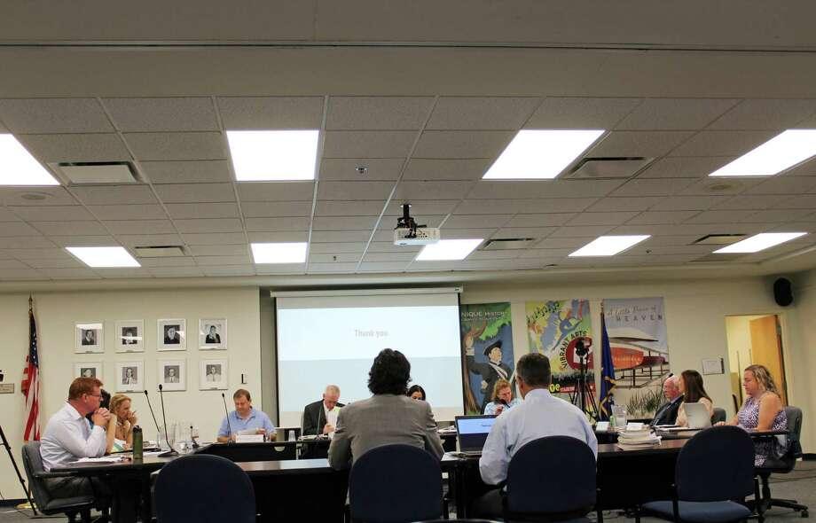 Ludlowe Principal Greg Hatzis, accompanied by new Warde Principal Paul Cavanna, presented to the Board of Education Tuesday night. Photo: Rachel Scharf / Hearst Connecticut Media