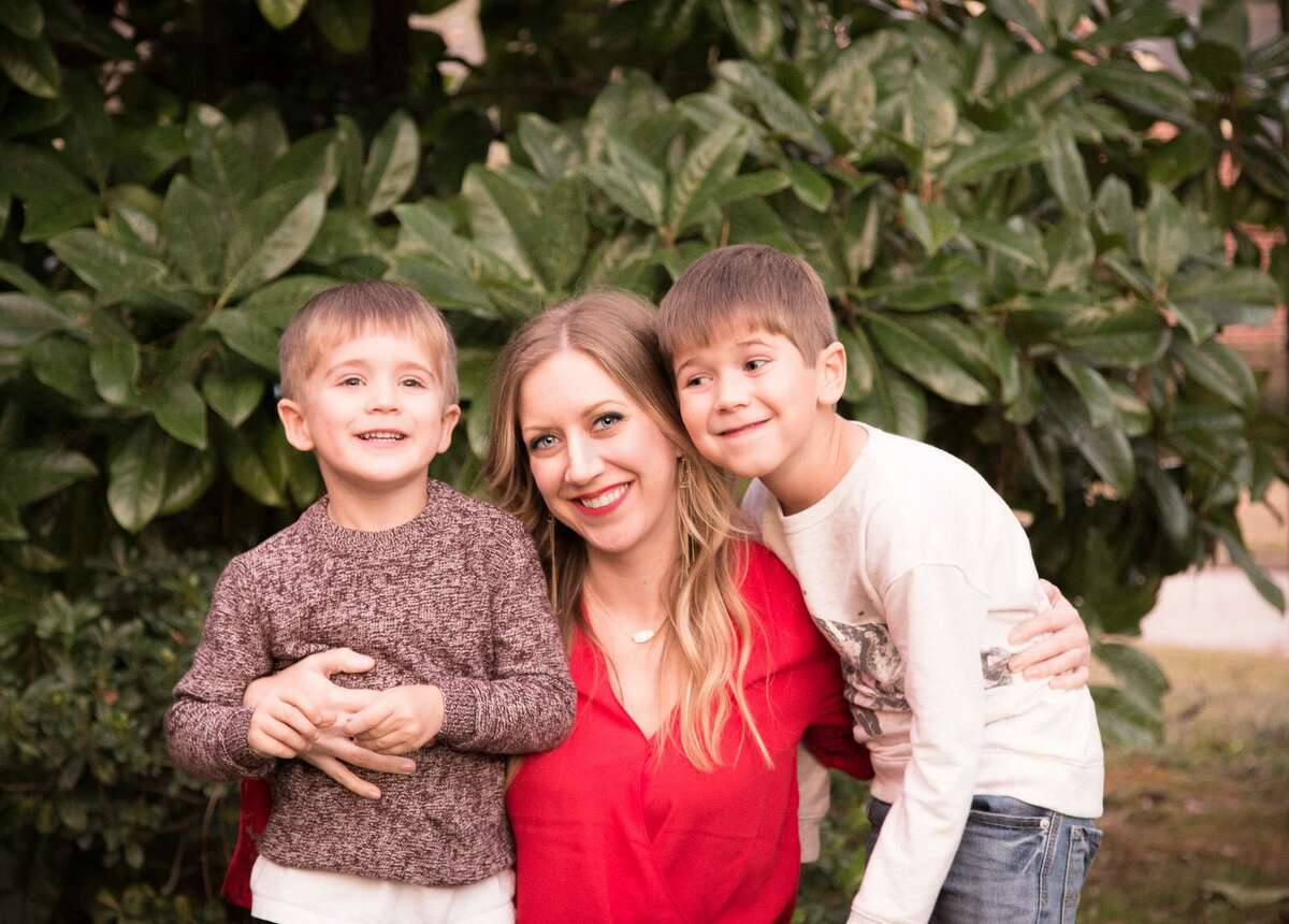 Lindsay Bowerman suffered a severe brain aneurysm at age 37 with no previous symptoms or family history. She's now an advocate for younger people getting screened for aneurysms which can be fixed if caught early. She's pictured here with her sons, Spencer and Trevor.