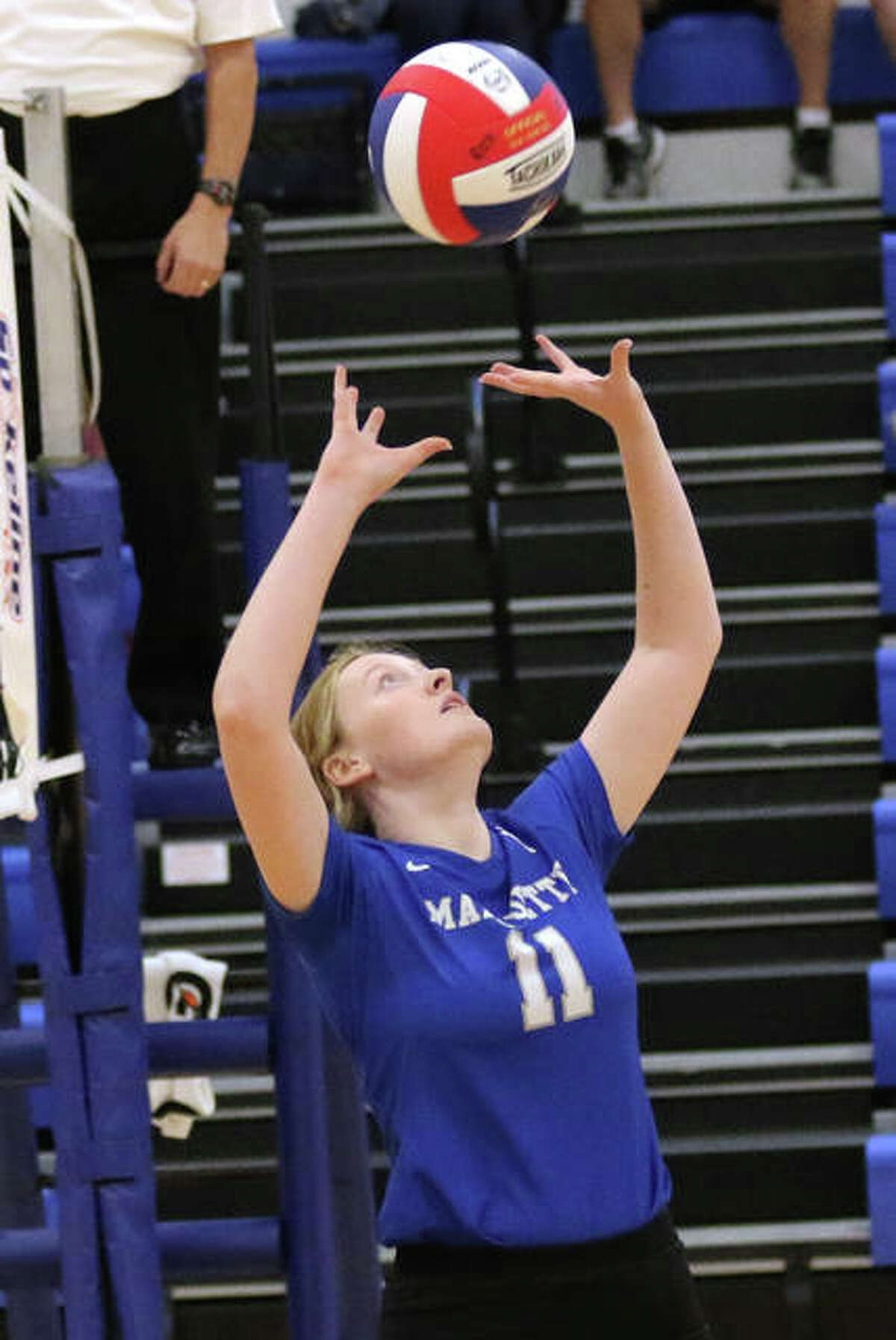 Marquette Catholic's Rachel Heinz sets during a match with Jersey on Tuesday at the Roxana Tournament.