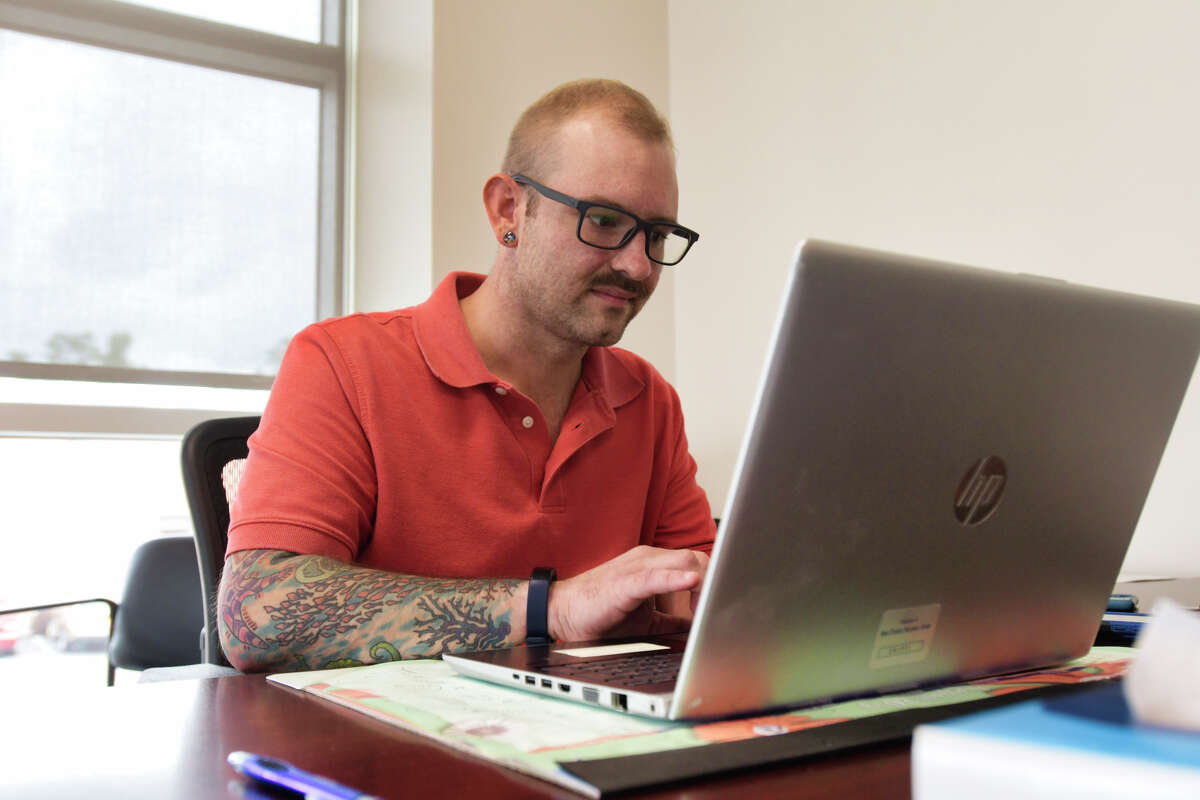Scott Heap, a certified recovery peer advocate at New Choices Recovery Center, works at the center on Tuesday, Aug. 27, 2019, in Schenectady, N.Y. (Paul Buckowski/Times Union)