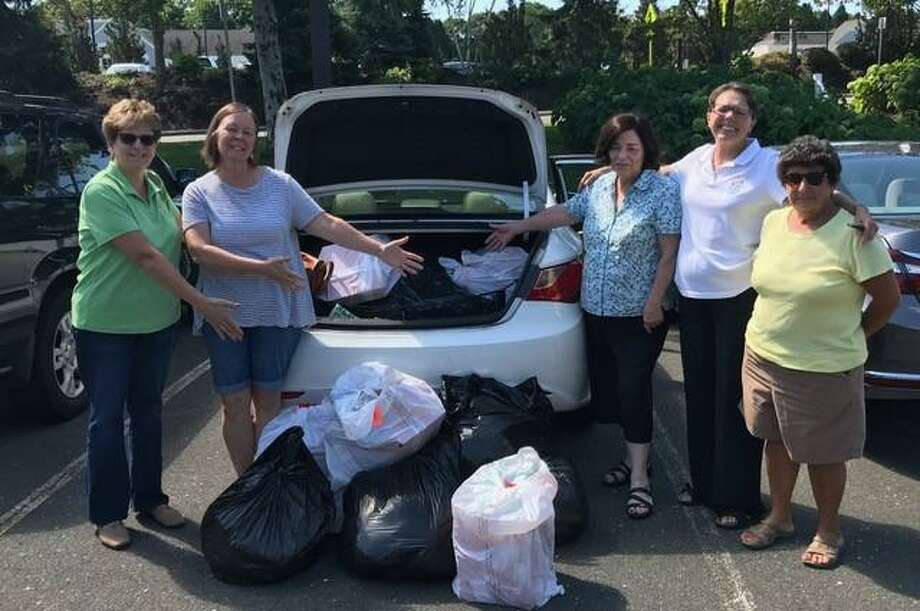 Trumbull Community Women collected new and used children's clothing on Saturday, Aug. 24, at the Trumbull Library. All donations benefitted the Bridgeport Rescue Mission and the Community Closet in Bridgeport. Shown loading up the car after the drive for Mercy Learning Center are Trumbull Community Women members are: Jo Lifrieri, Duly Chiappetta, Terri Malo, Liz Thomas and Lucille Jacozzi. Photo: Contributed Photo