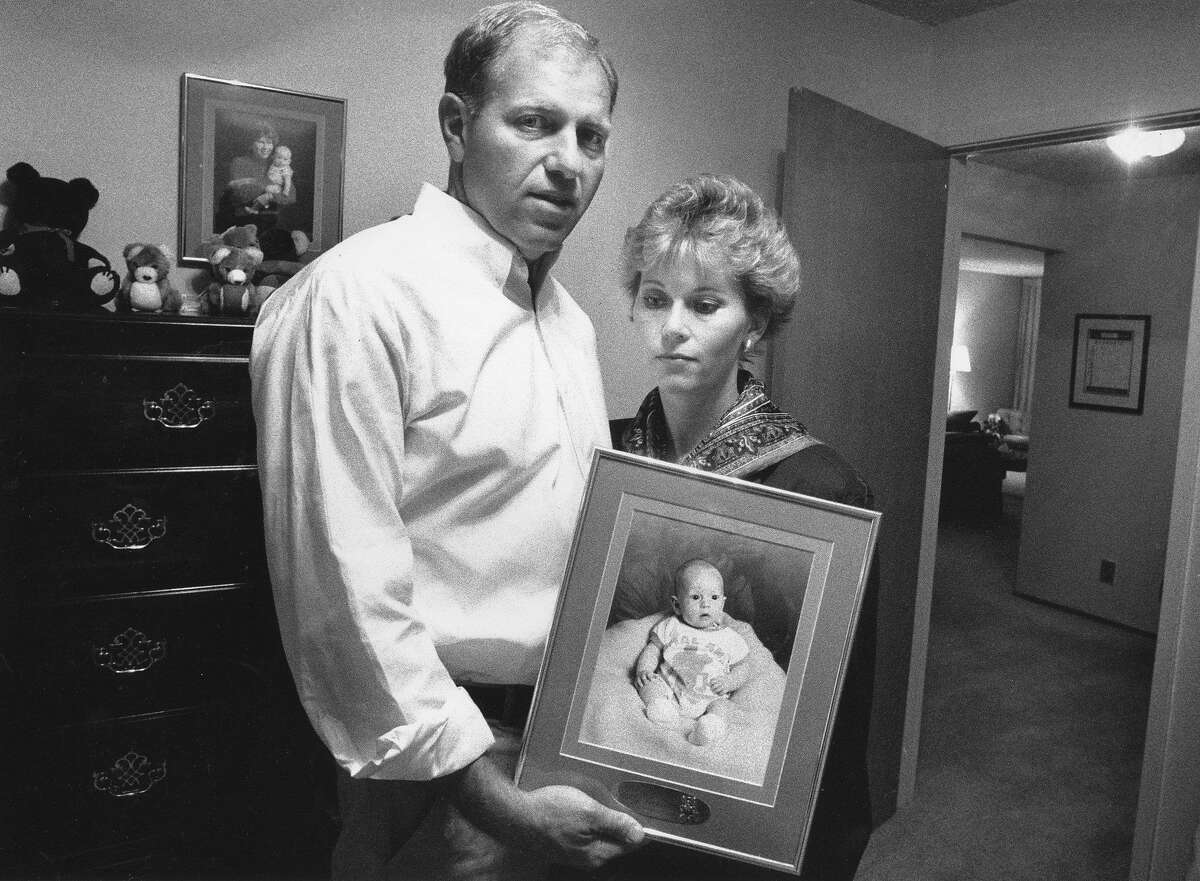 Walter and Carol Dickinson hold a picture of their 3-month-old son, Scott, who was one of 67 people killed by the Loma Prieta earthquake.
