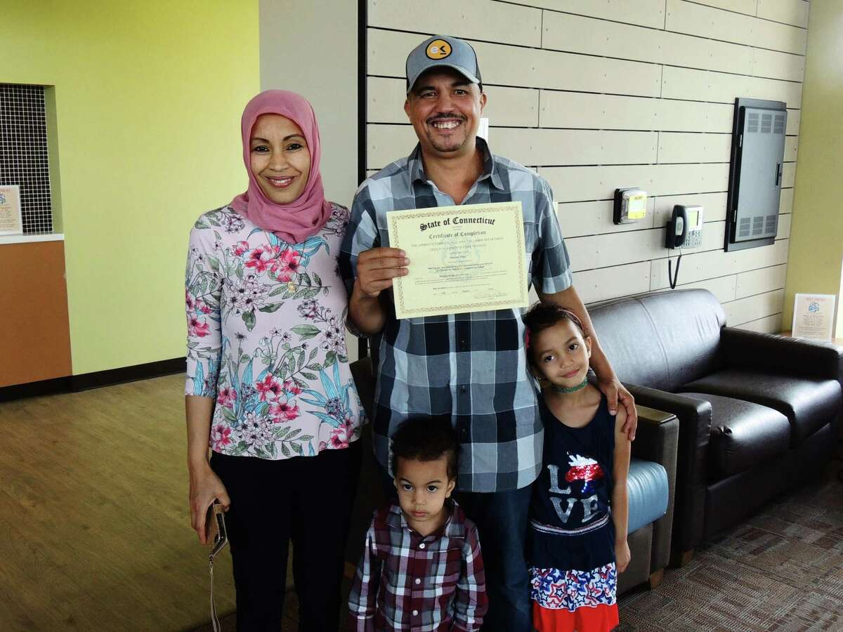 Middlesex Community College student Hassan Touil of Middletown, center, was joined by his family to celebrate completing Workforce Alliance's Skill Up for Manufacturing program Aug. 12.