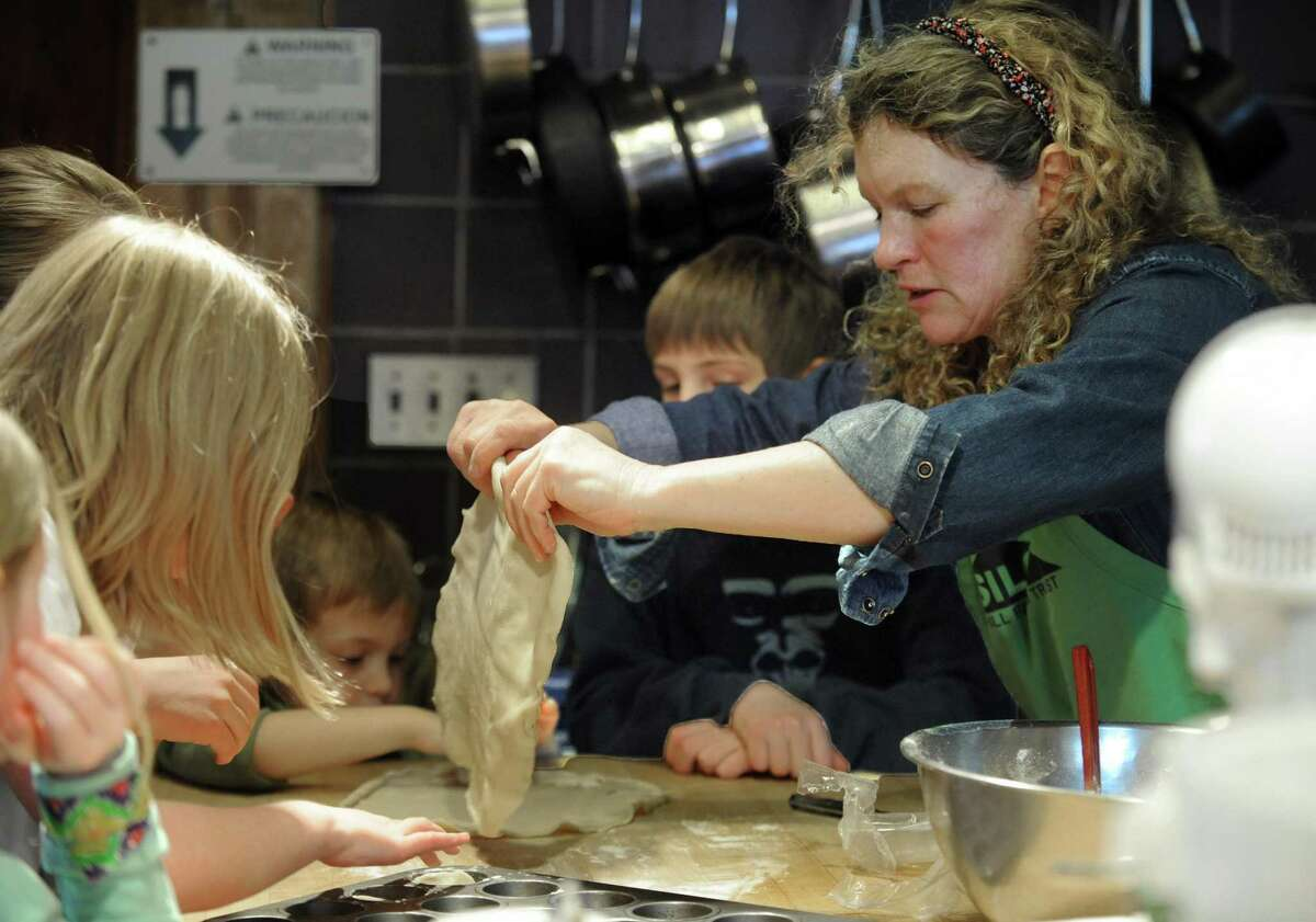 Cooking teacher Nancy Stuart of Bridgewater, leads a cooking class for kids at the Silo at Hunt Hill Farm in New Milford, in 2015. She is preparing dough for spinach gnocchi.