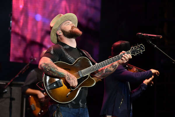"BOSTON, MA - JUNE 15: Zac Brown of Zac Brown Band performs on stage during the ""Down The Rabbit Hole"" Tour in Boston at Fenway Park on June 15, 2018 in Boston, Massachusetts. (Photo by Theo Wargo/Getty Images for Zac Brown Band)"