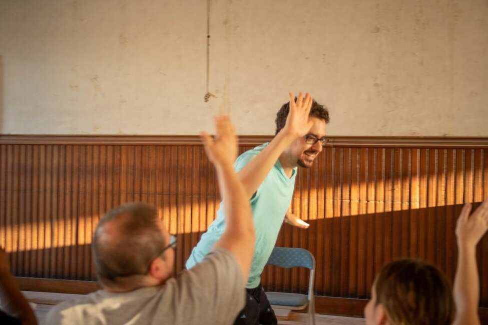 Every Brilliant Thing rehearsal with Steve Maggio with volunteer audience members. Photo by Megan Carr
