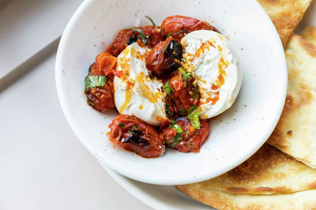 Burrata with charred tomatoes and herbed chili oil at Rosie Cannonball.