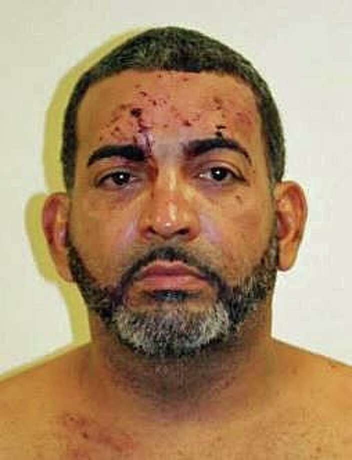 Manuel Vidal, 45, of Bridgeport, Conn. was arrested after leading police on a chase in several Massachusetts towns on Tuesday, Aug. 27, 2019. He was then booked at the West Bridgewater, Mass. police department for the following crimes occurring in West Bridgewater: Failure to stop for police, negligent operation of a motor vehicle, marked lanes violations, carrying a dangerous weapon, resisting arrest, possession with intent to distribute a Class B substance. Photo: West Bridgewater, Mass. Police Department