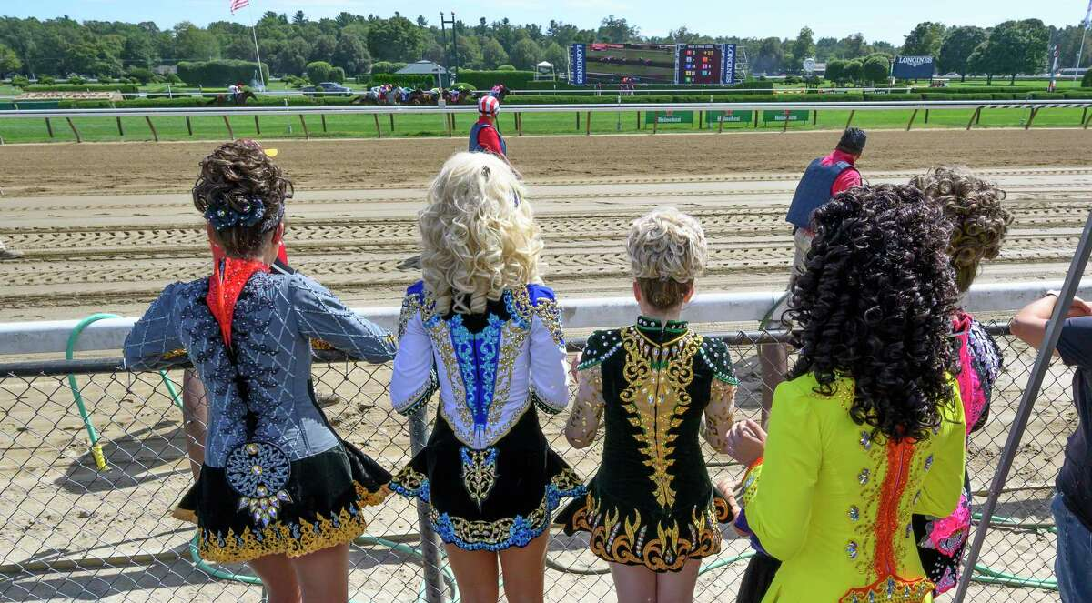 Members of the Boland School of Irish Dance watch the third race in their costumes before their performance on Irish-Italian Day at the Saratoga Race Course Wednesday August 28, 2019 in Saratoga Springs, N.Y. Photo Special to the Times Union by Skip Dickstein