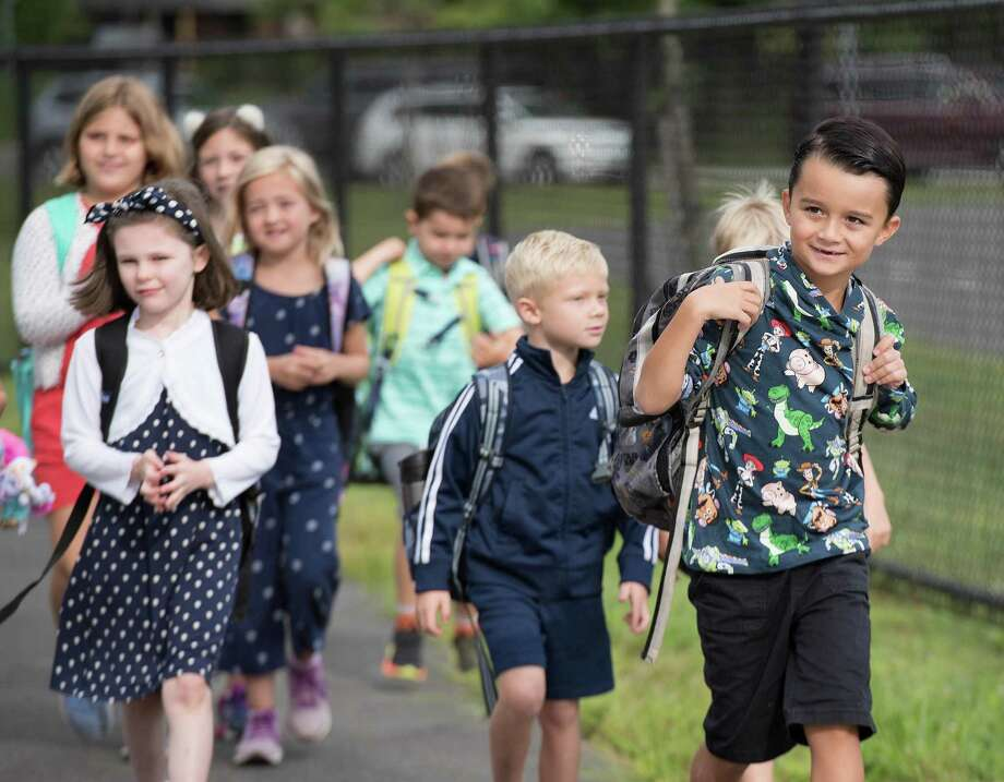 Students get off the bus for the first day of school at Miller-Driscoll on Tuesday, August 27, 2019 in Wilton, Connecticut. Students get off the bus for the first day of school at Miller-Driscoll on Tuesday, August 27, 2019 in Wilton, Connecticut. Photo: Bryan Haeffele / Hearst Connecticut Media / Hearst Connecticut Media