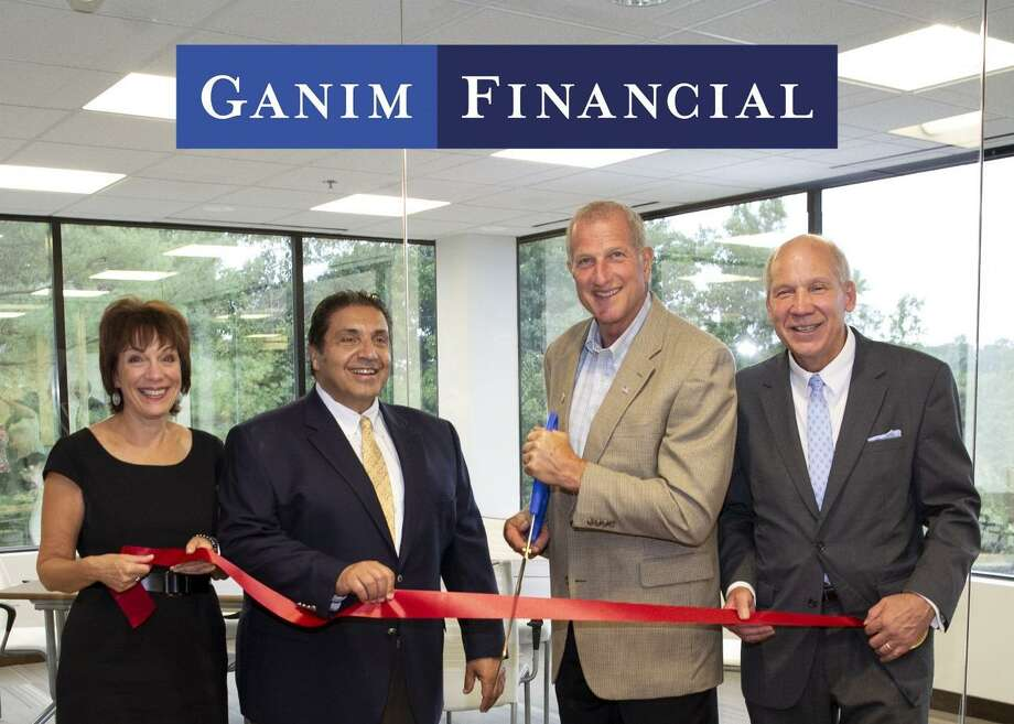 From left, Valerie Koch, VP/COO of Ganim Financial, Lawrence Ganim, CEO of Ganim Financial, Mayor Mark A. Lauretti and Bill Purcell, executive director of the Greater Valley Chamber of Commerce. Photo: Contributed Photo / Connecticut Post