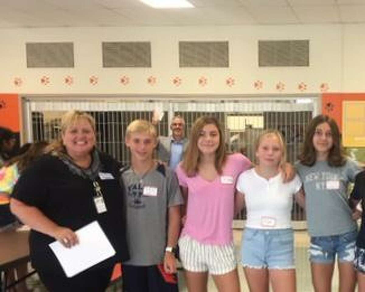 Sixth grade counselor Lisa Perry and East Ridge students Kyle Colsey, Truus van Wees, Eleanor Luft, and Eliza Forrest.