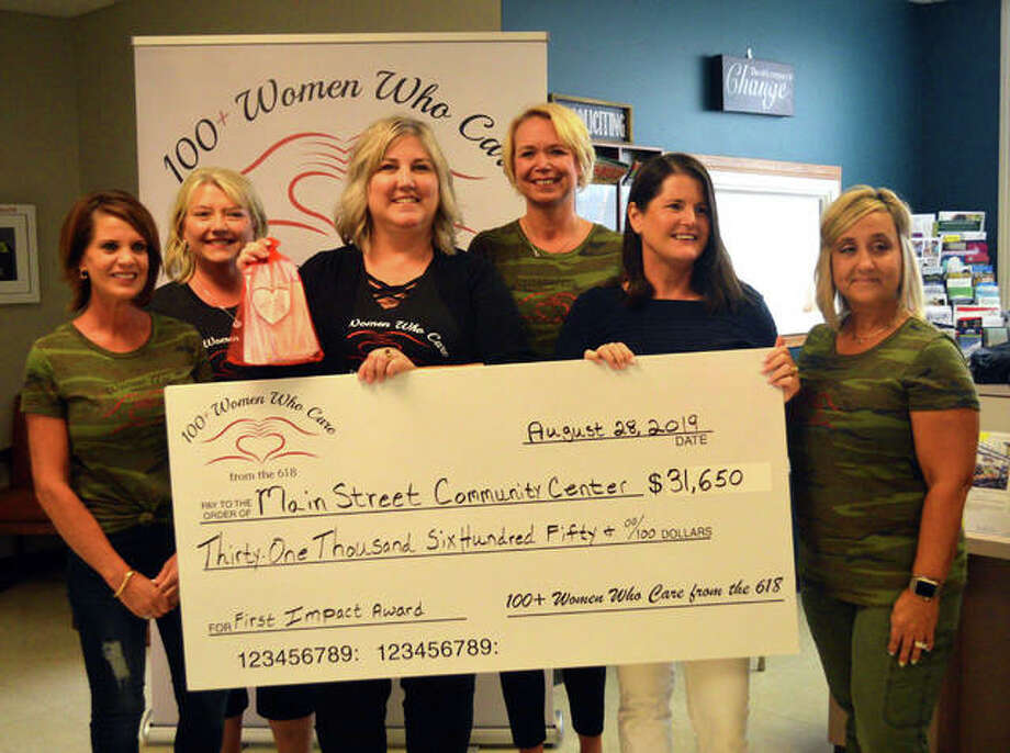 On Tuesday, officers and board members from 100+ Plus Women Who Care from the 618 presented a check for $31,650 to Main Street Community from its first quarterly impact meeting. From left to right are Christa Guilbeault, Sandy Knee, Main Street director Sara Birkbigler, Sarah Rankin, Deb Ellis and Denise Arendell. Photo: Scott Marion | The Intelligencer