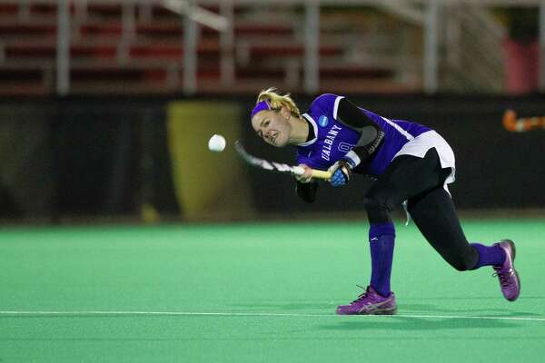 Paula Heuser fires a shot for the UAlbany field hockey team, playing in its first Final Four on Nov. 21, 2014, losing to third-ranked Connecticut 1-0 in an NCAA semifinal in College Park, Md.
