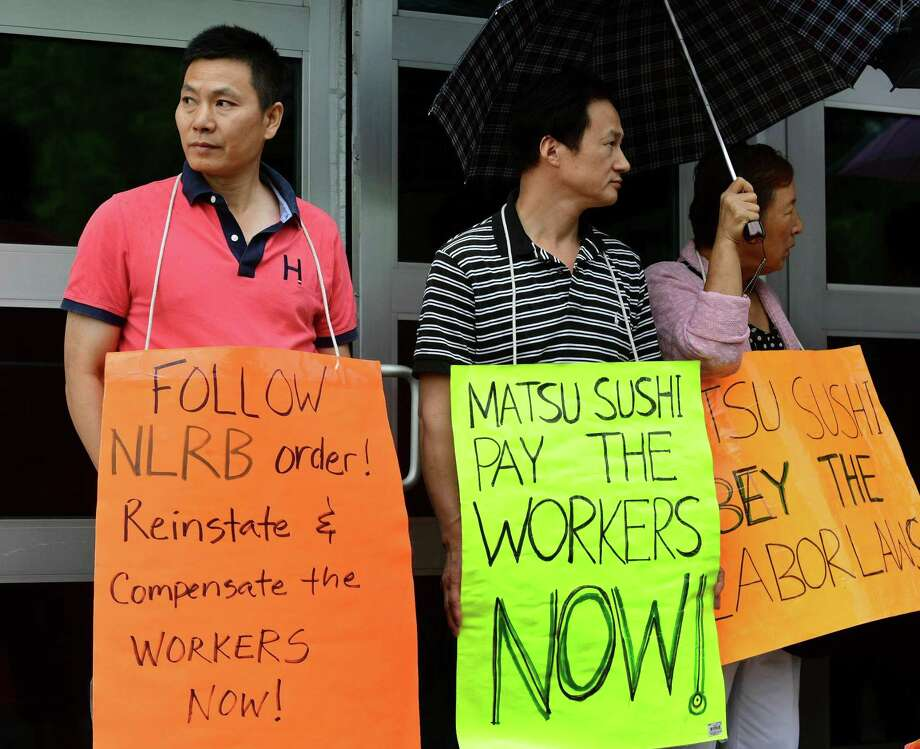 Matsu Sushi employees, protestors and labor leaders protest the firing two staff members during a picket of the restaurant Tuesday, August 13, 2019, in Westport, Conn. The two employees, Jianming Jiang and Liguo Ding, were fired in 2017 after they refused to work three consecutive shifts. Photo: Erik Trautmann / Hearst Connecticut Media / Norwalk Hour