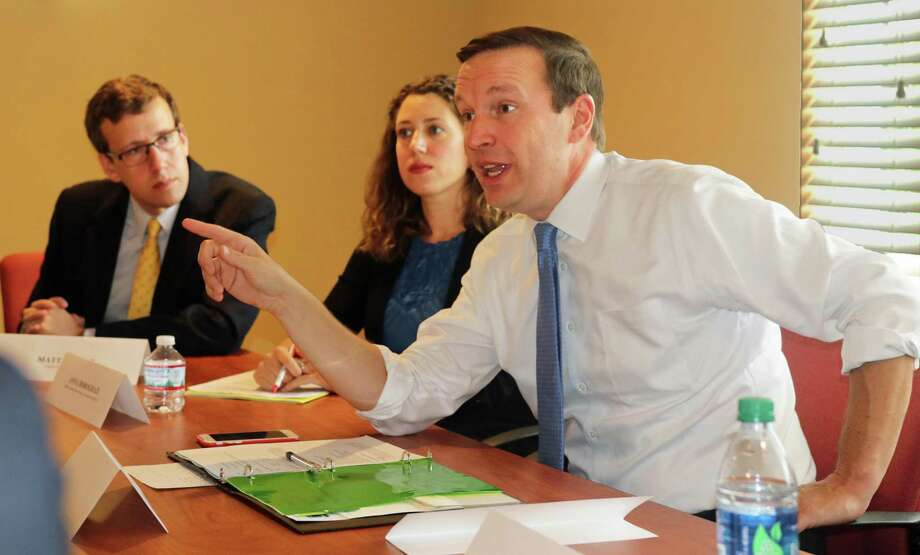 U.S. Sen. Chris Murphy, D-Connecticut, right, led a community discussion on prescription drug pricing at the Village at South Farms senior housing facility in Middletown Wednesday. At left is state Sen. Matt Lesser, D-Middletown, and center, Terry DiPietro, administrative director for behavioral health at Middlesex Health. Photo: Henry Chisholm Photo