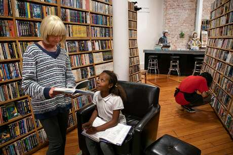 From left, Michelle Federle and her daughter Marissa Federle, 10, of Salinas browse for books at Downtown Books and Sound in Salinas. Photo: LiPo Ching / Special To The Chronicle